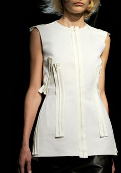 Deconstructed fashion details with raw edges & zippers used as adornment; alternative embellishment // Maison Martin Margiela