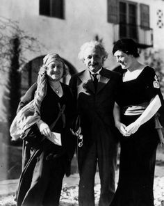 Albert Einstein and wife Elsa pose with psychic Gene Dennis in Palm Springs, January 1, 1932.