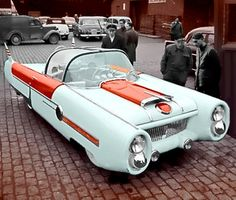 This Dream Car with gullwing doors was home built in (approx) 1955 by Almar Nordhaug, a Norwegian expat who lived in Tórshavn on the Faroe Islands. The futuristic build was based on a Vauxhall Cresta chassis, engine and drivetrain. The body was handmade, and the roof was taken from an airplane. In 1957 Nordhaug returned to Norway bringing his car with him. Black & white photo modified and partly colorized.