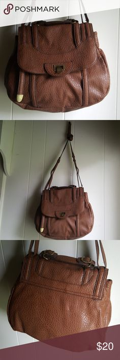 Jessica Simpson Bag Excellent condition!! The strap can be adjusted to liking. Very roomy and has plenty of pockets for storage. Jessica Simpson Bags Crossbody Bags