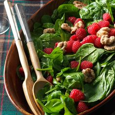 Spinach Salad with Raspberries & Candied Walnuts Recipe -I created a bright spinach salad with raspberries for Christmas dinner. Even those who turn up their nose at spinach change their mind at first bite. —Lory Aucelluzzo, Simi Valley, CA