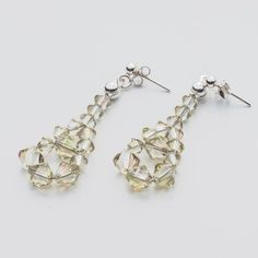 Swarovski Bicone Earrings 45mm Luminous Green  Dimensions: length: 4,5cm stone size: 4 and 6mm Weight ( silver) ~ 0,90g ( 1 pair ) Weight ( silver + stones) ~ 3,90g Metal : sterling silver ( AG-925) Stones: Swarovski Elements 5328 4 & 6mm Colour: Luminous Green 1 package = 1 pair  Price 7 EUR