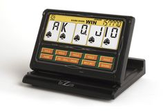 With a variety of different ways to play, the Portable Video Poker is a nice touch-screen device to have on hand. Automatic scorekeeping helps keep your poker playing versatile, complete with multiple variant play styles. Video Poker Games, Video Games List, Video Games For Kids, Peter O'toole, Las Vegas, Jokers Wild, Slot Machine Cake, Apps, Game Background