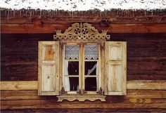 beautiful window and curtain with shutters. ornate--imagine as a headboard