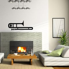 Bring more style to your home or business with this trendy trumpet glossy black vinyl sticker. Wall decals are an innovative, easy and inexpensive way to decorate your space.
