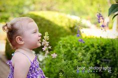 Children Photography Kansas City, MO Smelling the flowers at Kauffman Gardens http://www.forcephotographykc.com
