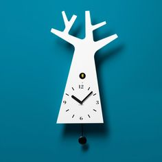 Tree clock, by Italian design house Miniforms.  On the hour, a little bird pops out of that hole there and delightedly marks the hour with its never-annoying but always-burbling birdsong. At Fab.com, $409 !!
