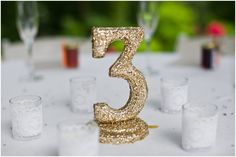 Table numbers to DIY.  Hill City Bride - Sincerely Liz Photography #diywedding #colorfulwedding #wedding #diy #signage #tablenumber #table #tabledecor