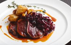 Venison leg cooked in hay with roast celeriac and braised red cabbage - Simon Rogan View the full recipe in the original website: greatbritis. Deer Recipes, Wild Game Recipes, Braised Red Cabbage, Great British Chefs, Food Plating, Plating Ideas, Venison Recipes, Pub Food, Game