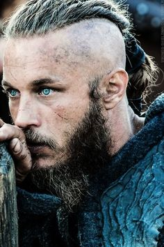 Travis Fimmel as Ragnar. Those eyes! I have to say he is so much hotter all rough and tumble instead of his pretty boy model style