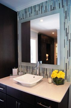 I always like the look of these skinny tiles. They look nice behind a mirror too