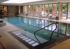 Lime Wood interior swimming pool designed by Guncast