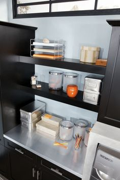 Decorative and functional, open shelves make great use of wall space, as shown here in Lexington Maple Black from Kitchen Craft.