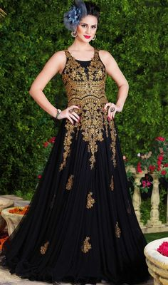 Look radiant and ravishing in this black color embroidered net floor length Anarkali suit. The wonderful lace, stones and resham work a considerable attribute of this attire. #blackanarkalidress #amazinganarkalicollection #longfloorlengthanarkalisuits