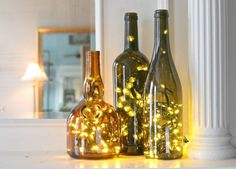 diy ideen Turn any glass bottle into a glowing focal point with little more than a string of LED Christmas lights and a diamond hole saw drill bit. Empty Wine Bottles, Recycled Wine Bottles, Lighted Wine Bottles, Bottle Lights, Wine Bottle Crafts, Bottle Art, Glass Bottles, Wine Bottle Lighting, Wine Bottle Trees