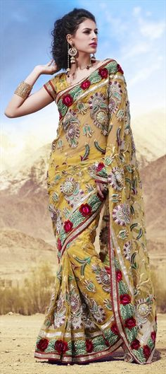 Getting into the mood of celebrating #GaneshChaturthi? Look your best with this lively colored saree.
