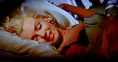 2 of 2 Marilyn Monroe in How To Marry A Millionaire.