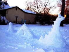 Loch Ness Snowman | Community Post: 40 Creative Snowmen and Other Snow Sculptures