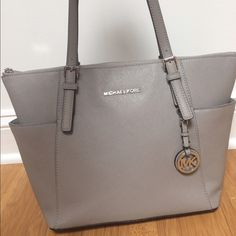 Grey Michael Kors Like New Selling my like new Michael Kors bag! This bag is practically brand new! No stains or signs of wear! Two side pockets, four interior pockets, a zippered divider, and silver hardware! Small dent in leather on front of purse, may be molded/steamed out with use. Guaranteed authentic. Selling for $149!!! Michael Kors Bags Shoulder Bags