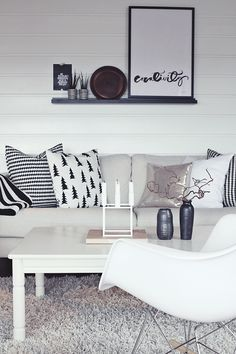 Scandinavian beauty ♥ I love the wall paneling, and the pine tree pillow. :)