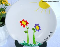 Make an easy artwork plate with a plastic plate and sharpies for Mother's Day!