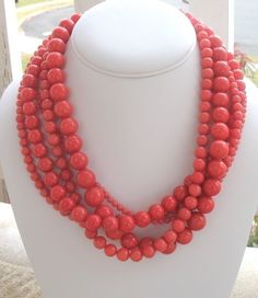 Chunky Necklace in Coral Pink Multi-Strand Statement Necklace, Serendipity Necklace. via Etsy.