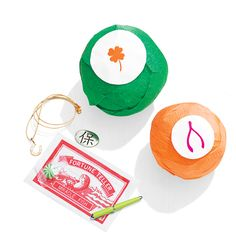 St. Patrick's Day Crafts: For a fun Saint Patrick's Day treat, skip the dyed-green milk and instead give the kids surprise balls filled with good-luck charms. They'll love unwrapping them as much as the toys they find inside. Click through for the DIY.