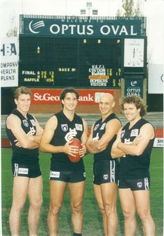 Michael Sexton, Stephen Silvagni, Milham Hanna and Fraser Brown by the old scoreboard, circa Carlton Afl, Carlton Football Club, Kelly's Heroes, Challenge Cup, Australian Football, Baggers, Go Blue, Great Team, My Passion