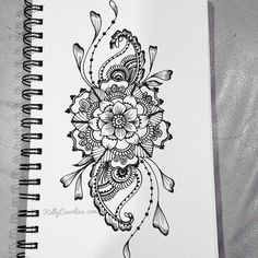 Sketched henna design with flowers and paisleys
