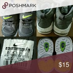 Toddler Shoes by Nike Max. Size 5. Hello Posh Community! These are dark gray + neon green Nike Max with writing on soles. Size 5. Please look at photos. Thanks for looking. Nike Max Shoes