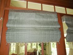 Close-up of a #Romanshade on #doors with trim top & bottom.   #windowtreatments www.LadyDiannes.com