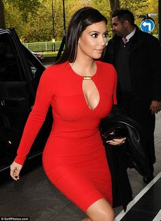 Kim Kardashian cut-out cleavage in a sexy red dress arriving at the Dorchester Hotel. #cleavage #boobs