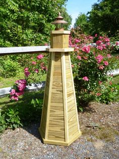 Lawn lighthouse wood plans with photos and step by step instructions.