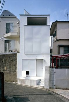 Long Tall House, Tokyo by Japanese architecture firm SPACESPACE. The home is sandwiched between two traditional residential buildings in a busy neighborhood, acting as a clean white escape from the chaos of the city.