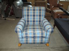 We recovered this Plaid Chair, put new foam in the seat. Touched up the wood. The upholster was James McKee, he did a great job. http://wardell-upholstery.com/