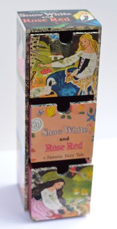 Add a touch of vintage magic to your childs room! ONE ONLY! set of three Treasure Drawers. Painstakingly designed and crafted from the 1973 Golden Book ed. Snow White and Rose Red: A Favorite Fairy Tale - Tenggren, G. Front edges of drawer compartments and each drawer is detailed with repurposed black and gold Golden Book binding. 33cm high x 11.5cm wide x 8.5cm deep. Finished with multiple coats of varnish to bring out the detail and colour, and to provide durability.