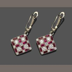 A pair of ruby, diamond and 18k white gold pendant earrings