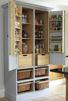Kitchen pantry I'd like.  Pasta in the drawers,  grabable kids snacks and potatoes in the baskets. Add those sliding wire shelves from Ikea to the regular shelves - perfect!
