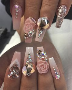 Light pink nails with 3D rose design and lots of gems!