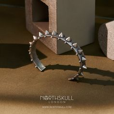 Make a bold statement with our spiked Egun Cuff in Aged Silver. Handcrafted by Italian artisans, this special bracelet will add a distinctive edge to your look. | Available now at Northskull.com [Worldwide Shipping] #Luxury #Jewelry #MensAccessories