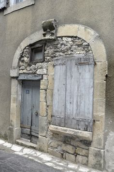 Fabulous mixture of textures for doors, shutters and wall, all encompassed within an arch. Barre des Cévennes