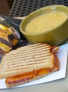 Eat Drink And Be Me: A You Pick Two combo at Panera Bread with a cup of Broccoli Cheddar Soup, half of a Chipotle Chicken Panini and a bag of chips.  Delicious!