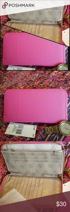 Adrienne Vittadini Saffiano Wallet Pretty in pink! This gorgeous zip around wallet is new with tags by Adrienne Vittadini. Adrienne Vittadini Bags Wallets