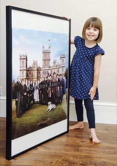 Fifi Hart's Downton Abbey souvenir is almost as big as she is