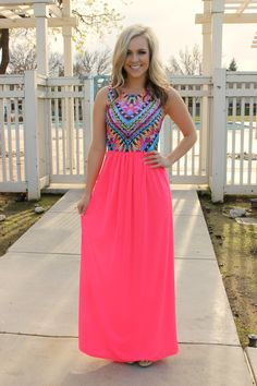 This dress is begging to go somewhere tropical! Will you be the one to let it feel the sea breeze? Bright and beautiful, this neon colored dress is anything but bland. Fitted, sleeveless bodice with f