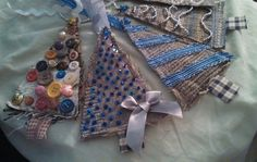 Christmas tree ornaments, hand-embellished tree cutouts from upholstery sample fabrics.