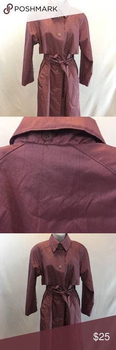 """Pink/purple trench coat. Raincoat. Oversized. Probably made in the 1980's, this coat is a women's size large or extra large, but please be sure to look at the measurements given below to ensure a proper fit. This item is belted and lined. It is in good clean condition and has 100% rubber backing over a polyester material. Condition stain and flaw free, except that it is missing the belts at the sleeves, and one button. It does not come with a hood. Price reflects condition. Measurements: 44""""…"""