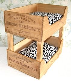 YES! finally! I have been wondering what exactly to do with the wine crates I have and this is PERFECT!!! diy kitty bed made from wine crates @mkd0514