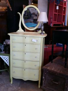 Tall pretty dresser with a mirror, how can you go wrong!