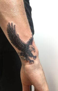 Many tattoos are drawn with a specific meaning and the eagle tattoos are among the most common. They are supposedly the most popular bird tattoos. These tattoos have been around for many years and many . Small Tattoos Men, Trendy Tattoos, Tattoos For Women, Cool Tattoos, Mens Wrist Tattoos, Arm Tattoos For Guys Forearm, Animal Tattoos For Men, Unique Tattoos For Men, Simple Mens Tattoos